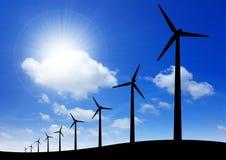 ветрянки захода солнца силуэта предпосылки Стоковые Фотографии RF