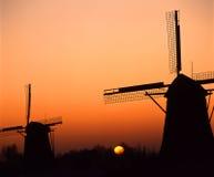 ветрянки захода солнца Стоковое Изображение RF