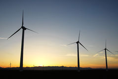 ветрянки захода солнца Стоковое Фото