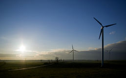 ветрянки захода солнца Стоковые Фотографии RF