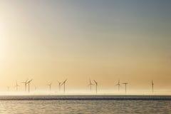 Ветрянки на восходе солнца в Голландии Стоковые Фото