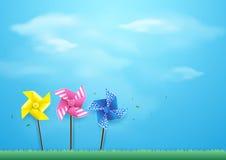 Ветрянки дуя в ветре на голубом небе бумажный стиль искусства бесплатная иллюстрация