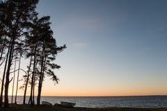 Вечер с rowboats морем Стоковые Фото