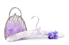 Вешалка, сумка и фиолет Стоковое фото RF