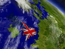 Великобритания с врезанным флагом на земле Стоковое Фото