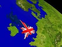 Великобритания с флагом на земле Стоковое Изображение