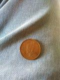 Великобританская индийская монетка стоковое изображение rf