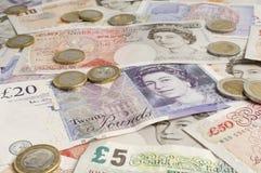 Великобританские бумажные деньги и монетки Стоковые Фотографии RF