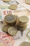 Великобританские бумажные деньги и монетки Стоковое Фото