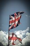 Великобританский флаг Юниона Джек дуя в ветре Стоковое фото RF