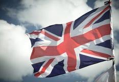 Великобританский флаг Юниона Джек дуя в ветре Стоковое Изображение RF