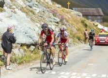 3 велосипедиста в горах - Тур-де-Франс 2015 Стоковое Фото