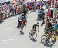 3 велосипедиста на Col du Glandon - Тур-де-Франс 2015 Стоковое Изображение