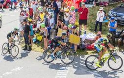 3 велосипедиста на Col du Glandon - Тур-де-Франс 2015 Стоковая Фотография