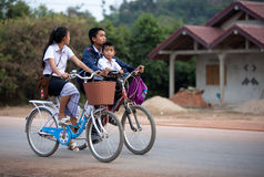 Велосипедист в Лаосе Стоковые Изображения