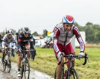 Велосипедист Joaquim Родригес на мощенной булыжником дороге - Тур-де-Франс Стоковое Изображение RF
