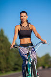 Велосипед катания девушки Стоковые Изображения RF