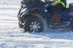 Велосипед квада в снеге Стоковые Фотографии RF