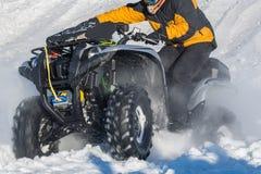 Велосипед квада в снеге Стоковая Фотография