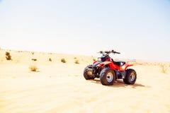 Велосипед квада на песчанной дюне Стоковая Фотография