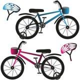 Велосипеды и шлемы детей, синь и пинк Стоковое фото RF