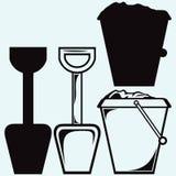 Ведро и лопата с песком, ребенк забавляются символ инструментов Стоковые Изображения RF