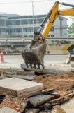 Ведро Backhoe на строительной площадке стоковое фото
