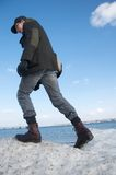взбираясь человек айсберга Стоковое Фото