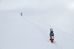 взбираясь snowboarder Стоковые Фото