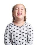 взволнованности Маленькая девочка смеется над крепко Предпосылка изолированная белизной Стоковое Изображение