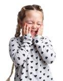 взволнованности Немногое курчавое держать его щеки с его руками и shy Предпосылка изолированная белизной Стоковое Изображение