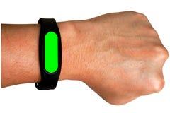 Взгляд людей на наручных часах Запястье руки, рука, на белой предпосылке Зеленый экран на вахтах стоковое изображение