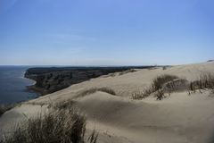 Взгляд мертвых дюн, вертела Curonian и лагуны Curonian стоковое фото rf