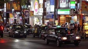 Взгляд на ноче - занятый район улицы Shibuya в ТОКИО/ЯПОНИИ - 12-ое июня 2018 Токио сток-видео