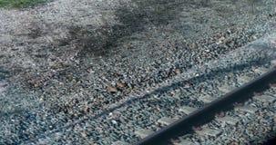 Взгляд на рельсах из окна двигая поезда видеоматериал