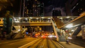 Взгляд ночи района финансового района Гонконга центральный от двигать Стоковые Изображения