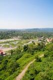 Взгляд от запруды для того чтобы благоустраивать провинцию Nakhon Nayok в Таиланде Стоковая Фотография