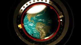 Взгляд от иллюминатора космической станции земля сток-видео
