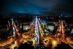 взгляд от Триумфальной Арки на ноче, изображении фото красивый панорамный взгляд города столичного жителя Парижа стоковые фото