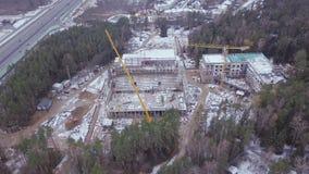Взгляд сверху видит строительную площадку многоэтажного здания бетона армированного зажим Взгляд сверху строительной конструкции Стоковая Фотография
