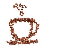 Взгляд сверху конца-вверх кружки кофейного зерна дальше стоковое фото