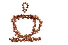 Взгляд сверху конца-вверх кружки кофейного зерна дальше стоковая фотография