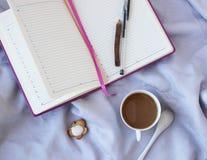 Взгляд сверху кофе и дневника Стоковые Фотографии RF