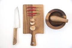 Взгляд сверху подготовки еды в кухне на белой предпосылке Стоковое Изображение