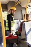 взгляд со стороны работника в форме с набором инструментов в катании руки Стоковые Изображения RF