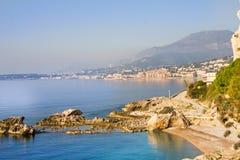 Взгляд Menton от пляжа в Ventimiglia Стоковая Фотография