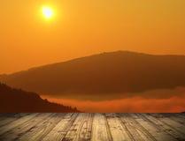 Взгляд восхода солнца от деревянной террасы Стоковые Изображения RF