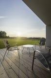 Взгляд захода солнца от современного патио стоковое фото rf