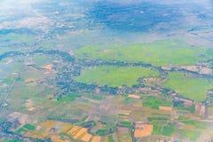 Взгляд земли от окна самолета Стоковое фото RF