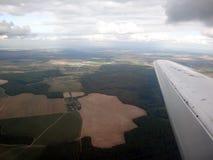 Взгляд земли от самолета Стоковая Фотография RF